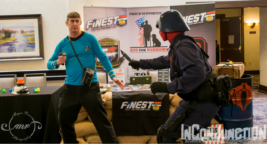 A man dressed as Spock and a man dressed as Cobra Commander square off